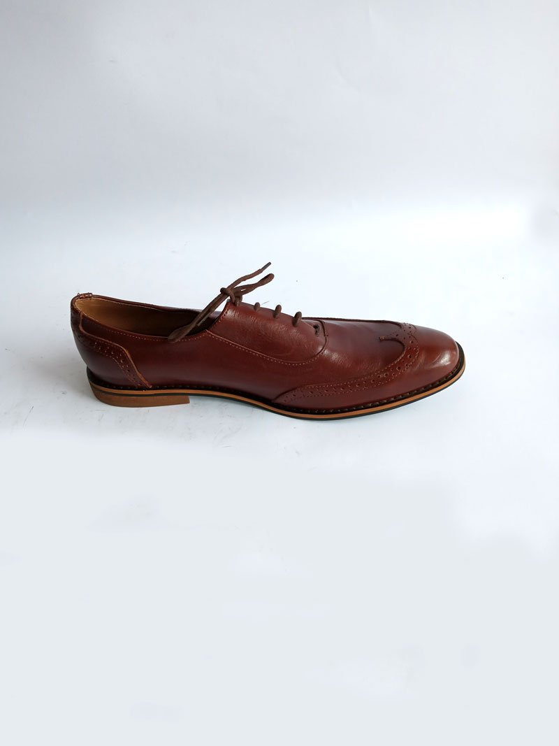 men leather brown shoe.